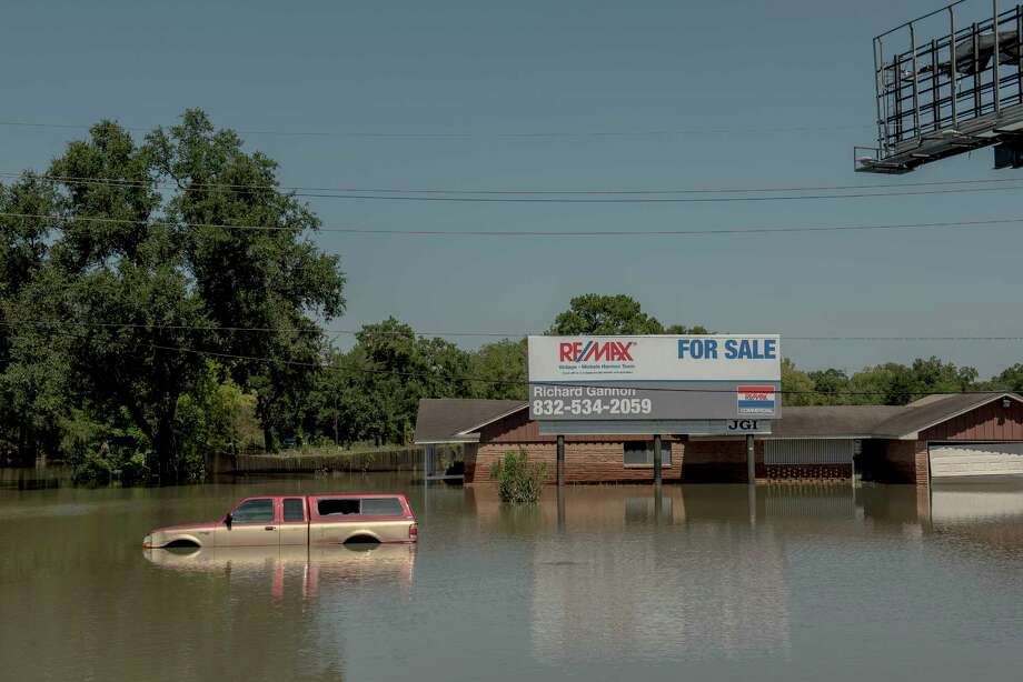 Pew research finds that Americans are more likely to believe they control their own destiny, while Europeans tend  to value the role of the state. In this photo: A flooded property visible from I-10 after Harvey. Photo: GEORGE ETHEREDGE, NYT / NYTNS