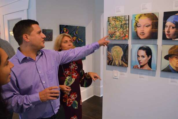 Alex Dacosta of Shelton admires some artwork at the open house and art sale at 5 Ridgewood Lane, Saturday, Oct. 7, 2017, in Westport, Conn.