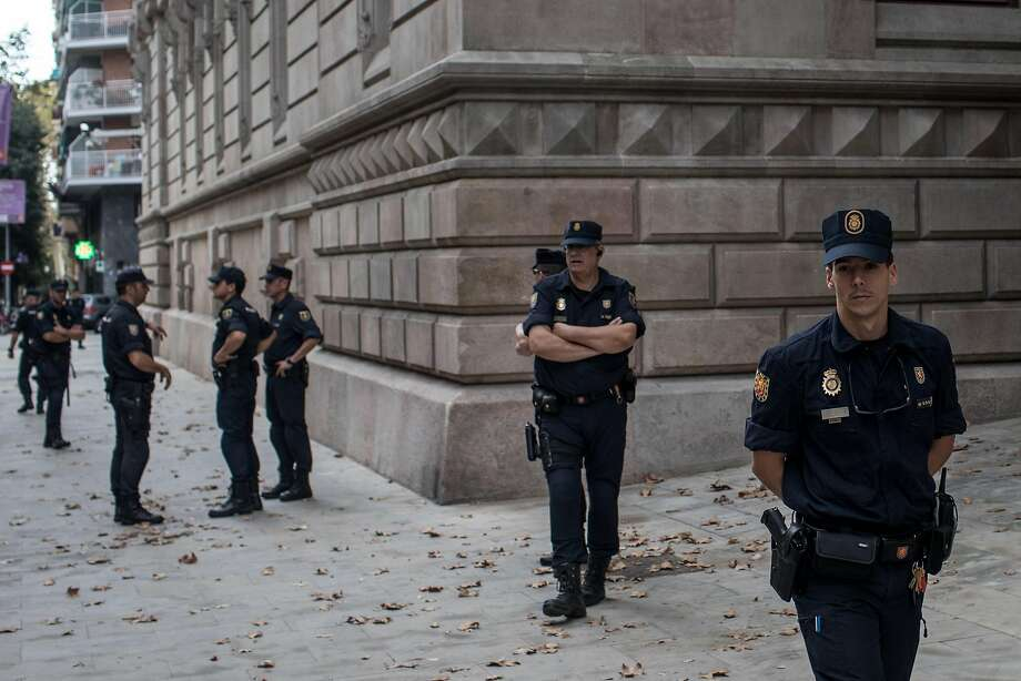 Spanish National Police patrol at a courthouse in Barcelona after taking control from Catalan officers. Photo: Chris McGrath, Getty Images