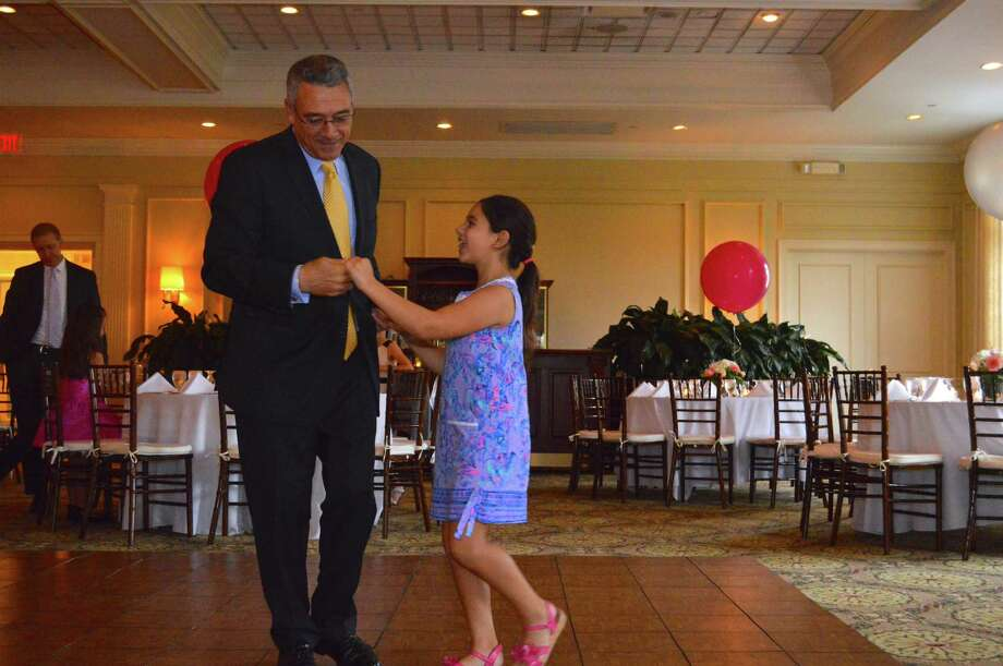 Bill Vellante of New Canaan dances with his daughter, Olivia, 8, at the second annual New Canaan Father Daughter Dance, held at Woodway Country Club, Sunday, Oct. 8, 2017, in Darien, Conn. Photo: Jarret Liotta / For Hearst Connecticut Media / New Canaan News Freelance