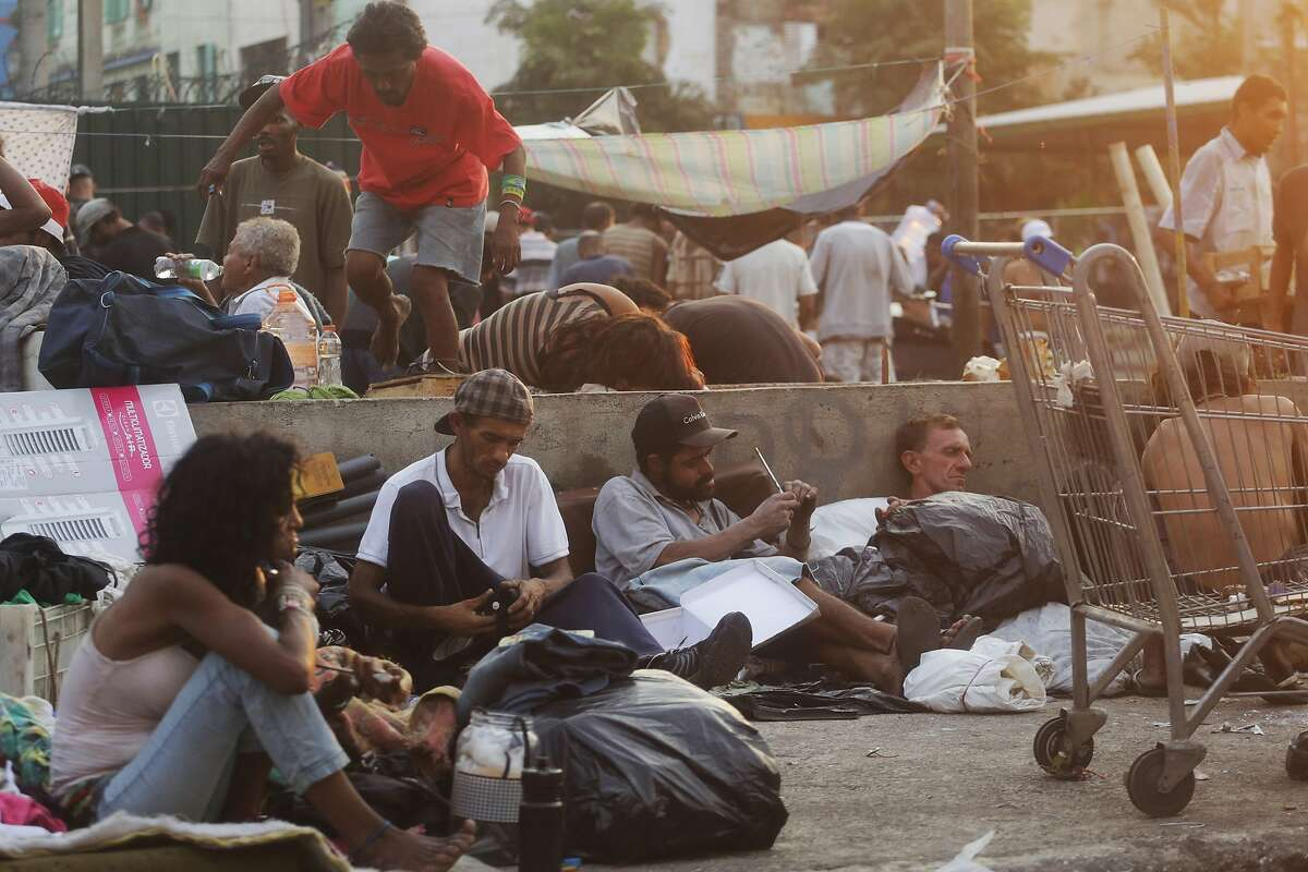 In this Sept. 17, 2017 photo, drug addicts gather in a plaza of an area popularly known as