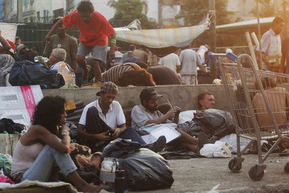 """Drug addicts gather last month in the area known as """"Crackland"""" in central Sao Paulo. For two decades, city leaders have tried different approaches to eliminate up the blight. Yet it persists. Photo: Nelson Antoine, Associated Press"""