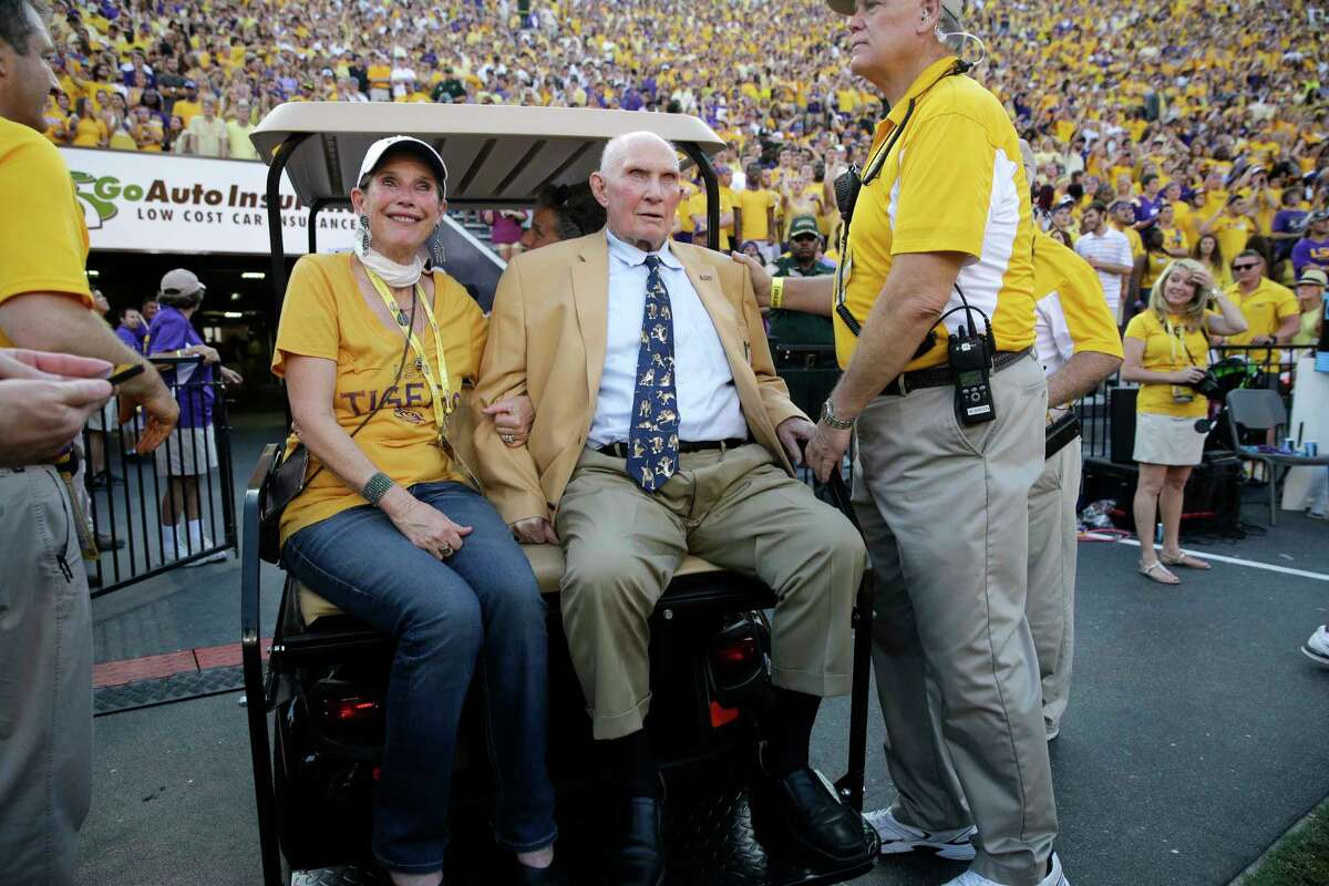 FILE - In this Sept. 20, 2014, file photo, NFL great and LSU alumnus Y.A. Tittle, center, arrives in Tiger Stadium in the first half of an NCAA college football game between LSU and Mississippi State, in Baton Rouge, La. Tittle, the Hall of Fame quarterback and 1963 NFL Most Valuable Player, has died. He was 90. His family confirmed to LSU, where Tittle starred in college, that he passed away. No details were immediately provided.