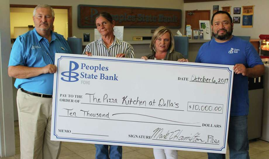 Small business owner Della Cash (second from left) receives a check from Peoples State Bank to support her business, Della's Pizza Kitchen. From left,  President and CEO Mark Hamilton, Cash, Vice President Renee Smith and Compliance Officer Ruben Villa. Photo: Jacob McAdams