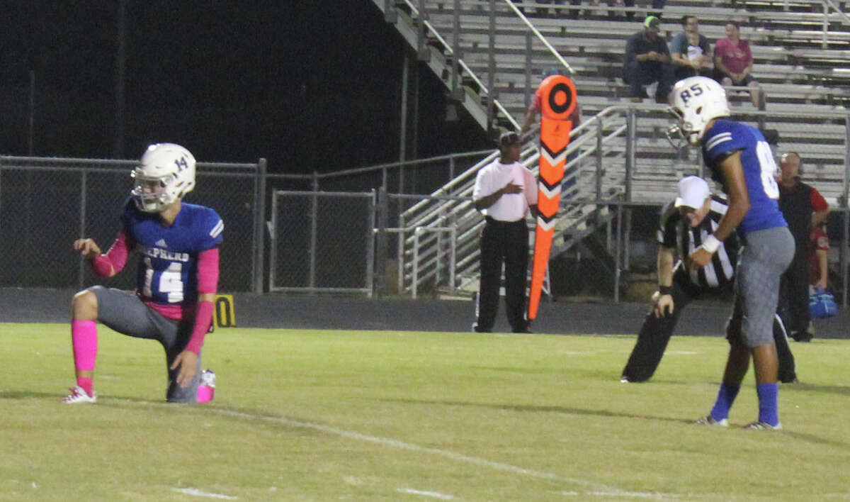 Shepherd Pirate Nick Truelove (left) prepares to receive the ball so Joel Valdez (right) can make a PAT.