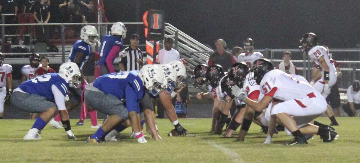 The Shepherd Pirates (blue) prepare to play offense against the Huntington Red Devils (white) in their Oct. 6 football game.