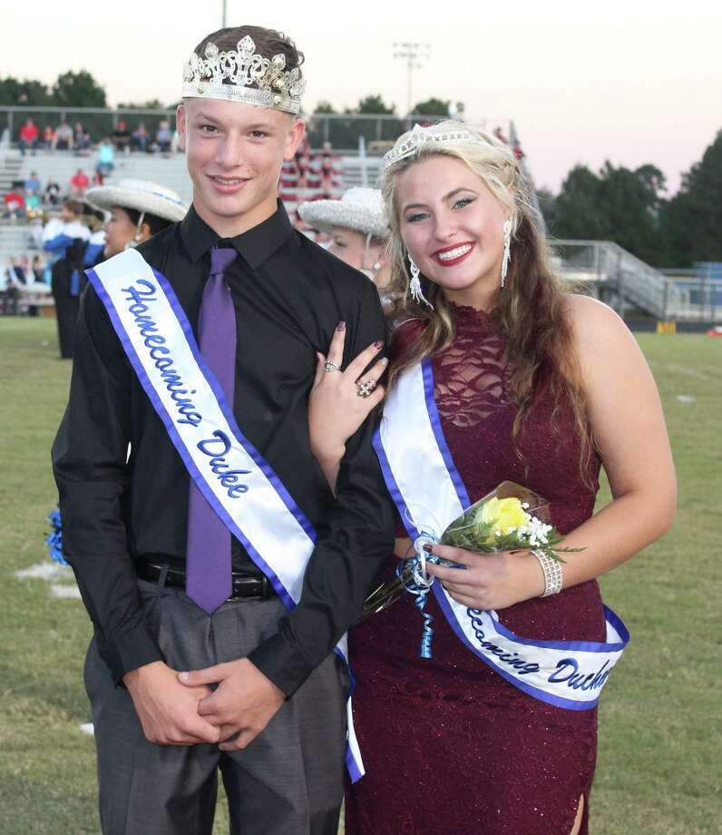Sophomore Duke Cody Chreene (left) escorts Sophomore Duchess Dally Hightower (right) onto the Shepherd High School football field for homecoming. Photo: Jacob McAdams