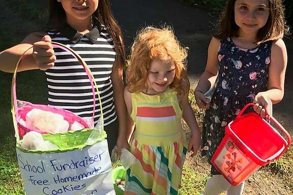 Presidio Hill schoolgirls selling brownies to benefit scholarships at Hardly Strictly Bluegrass
