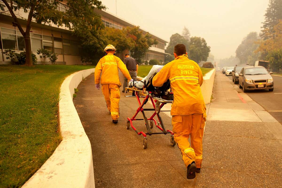 Paramedics from Guerneville enter the at the Sonoma Developmental Center during a mandatory evacuation as the Tubbs Fire threatens the town of Glen Ellen, Calif. on Monday, Oct. 9, 2017.