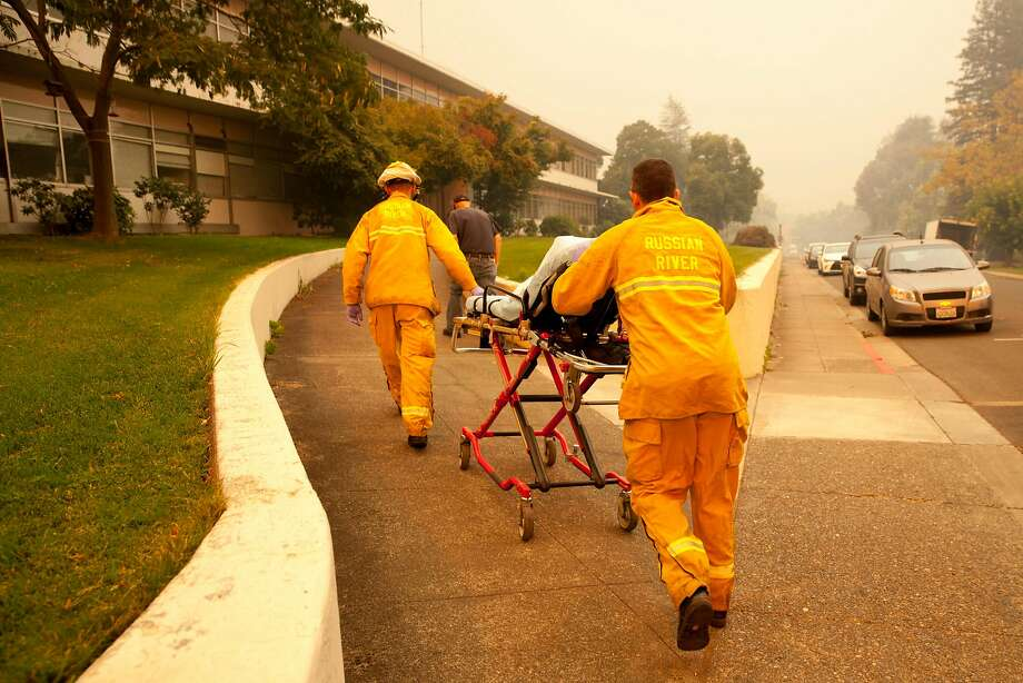 Paramedics from Guerneville enter the at the Sonoma Developmental Center during a mandatory evacuation as the Tubbs Fire threatens the town of Glen Ellen, Calif. on Monday, Oct. 9, 2017. Photo: Peter DaSilva, Special To The Chronicle
