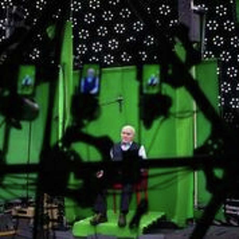 """Holocaust survivor Pinchas Gutter records the interview that will allow him to """"speak"""" to Holocaust Museum Houston visitors in a revolutionary interactive room, via a hologram. Photo: Holocaust Museum Houston"""