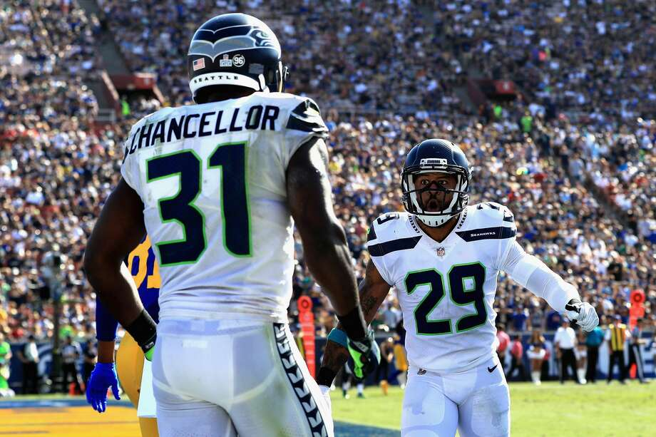 Kam Chancellor celebrates a broken pass play with  Earl Thomas #29 of the Seattle Seahawks during the second half of a game against the Los Angeles Rams   at Los Angeles Memorial Coliseum on Oct. 8, 2017. Photo: Sean M. Haffey/Getty Images