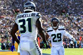 Kam Chancellor celebrates a broken pass play with  Earl Thomas #29 of the Seattle Seahawks during the second half of a game against the Los Angeles Rams   at Los Angeles Memorial Coliseum on Oct. 8, 2017.