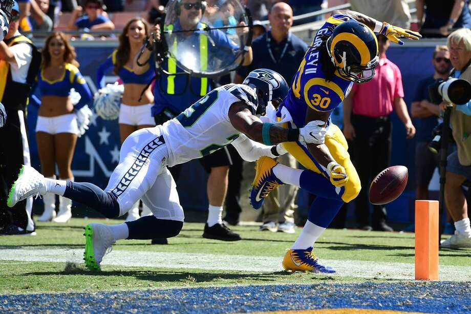 LOS ANGELES, CA - OCTOBER 08:  Todd Gurley #30 of the Los Angeles Rams runs a 12-yard touchdown which was overturned and ruled a fumble that went out of bounds in the end zone during the game against the Seattle Seahawks at the Los Angeles Memorial Coliseum on October 8, 2017 in Los Angeles, California.  (Photo by Harry How/Getty Images) Photo: Harry How/Getty Images