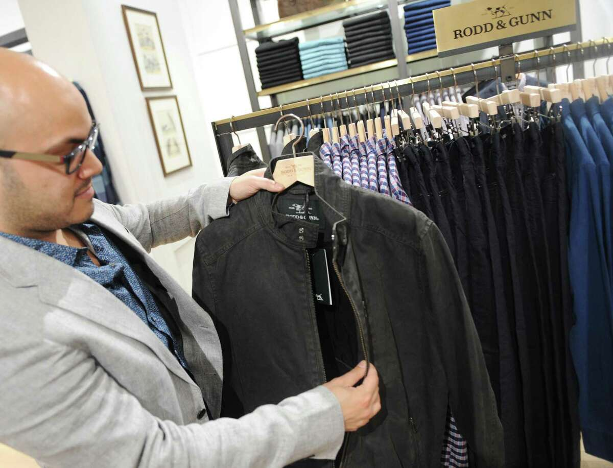 Store manager Marc Marranzino shows the Jack Reacher jacket, worn by Tom Cruise, at the New Zealand-based men's clothing store Rodd & Gunn along Greenwich Avenue in Greenwich, Conn. Wednesday, Oct. 4, 2017.