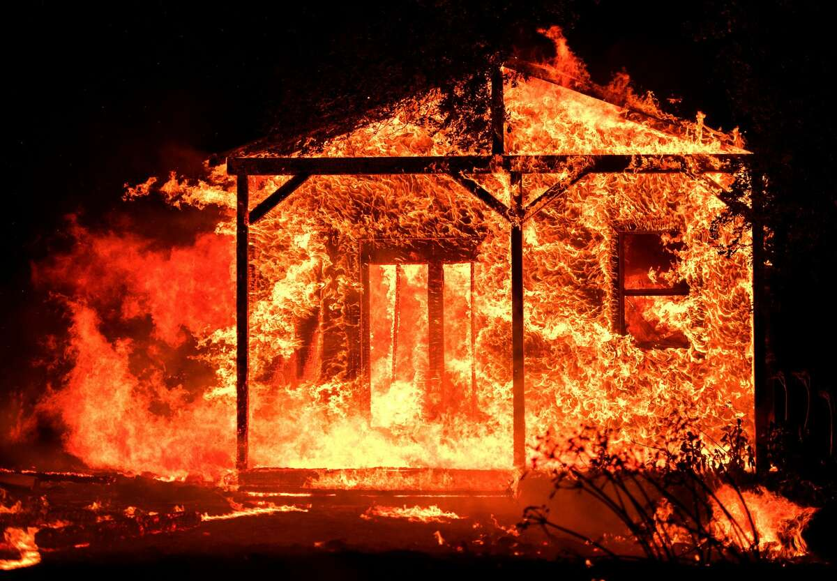 Flames overtake a structure as nearby homes burn in the Napa wine region in California on October 9, 2017, as multiple wind-driven fires continue to whip through the region. / AFP PHOTO / JOSH EDELSON (Photo credit should read JOSH EDELSON/AFP/Getty Images)