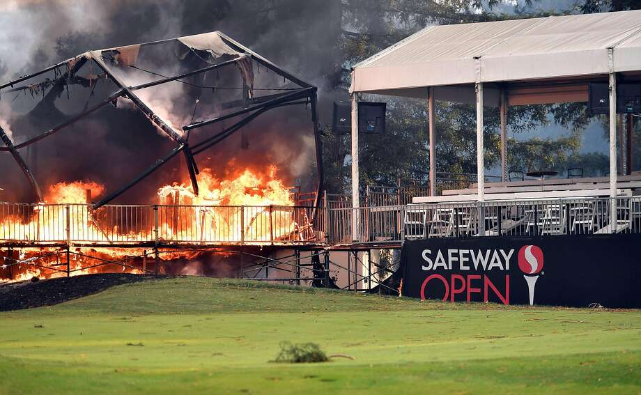 A tent structure built for the 2017 Safeway Open burns on a golf course at the Silverado Resort and Spa in Napa, California on October 9, 2017, as multiple wind-driven fires continue to whip through the region.  / AFP PHOTO / JOSH EDELSONJOSH EDELSON/AFP/Getty Images Photo: JOSH EDELSON, AFP/Getty Images