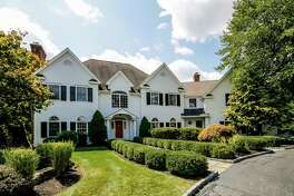 The stately white colonial house at 167 Sturges Ridge Road was recently completely renovated, giving it a transitional feel with an open floor plan.