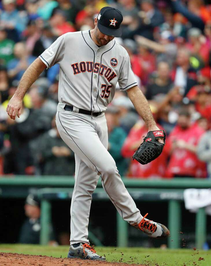 Houston Astros starting pitcher Justin Verlander (35) kicks the dirt after giving up a 2-run home run by Boston Red Sox left fielder Andrew Benintendi during the fifth inning of Game 4 of the ALDS at Fenway Park on Monday, Oct. 9, 2017, in Boston. Photo: Karen Warren, Houston Chronicle / © 2017 Houston Chronicle