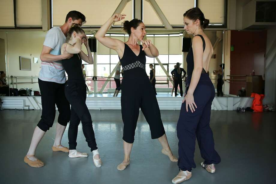 """Choreographer Marika Brussel (center) directs a rehearsal of """"From Shadows"""" at ODC Theater in San Francisco. Photo: Santiago Mejia, The Chronicle"""