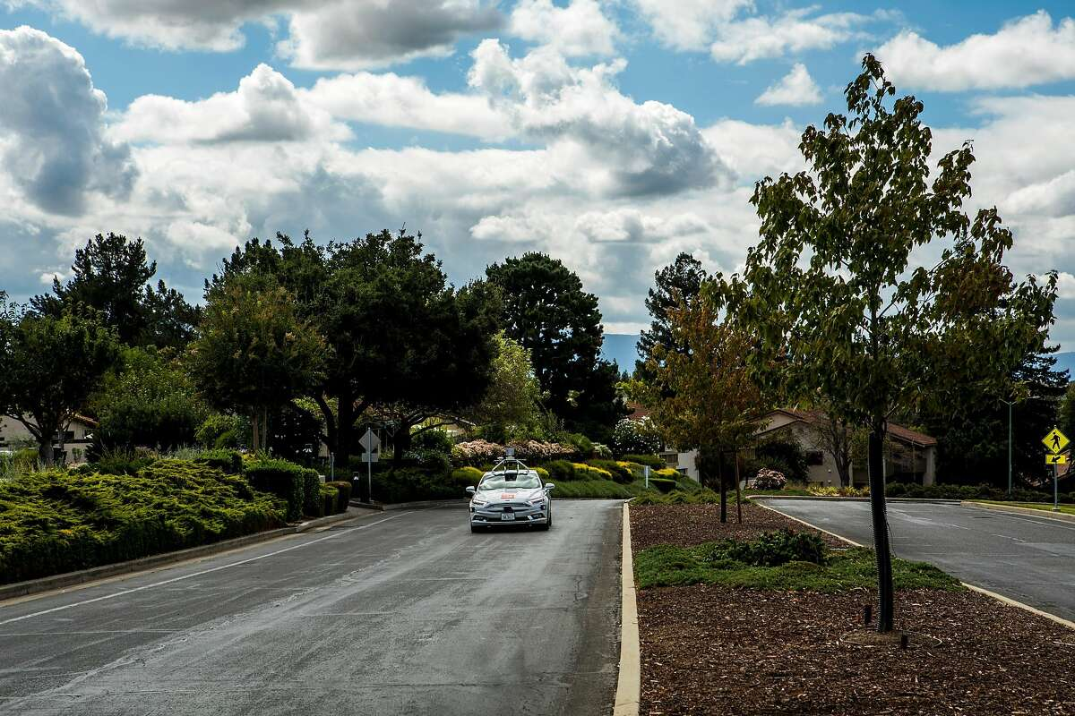 A Voyage self-driving car inside the Villages Golf and Country Club in San Jose, Calif., Sept. 20, 2017. The startup is looking to expand its autonomous taxi service beyond this retirement community, where the vehicles currently operate on a busy two-mile loop with a driver on hand in case something goes awry. (Christie Hemm Klok/The New York Times)