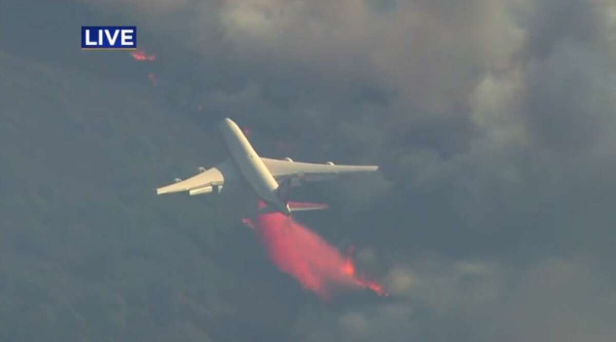 CalFire deployed its SuperTanker 747 to combat devastating fires burning in Wine Country Monday.