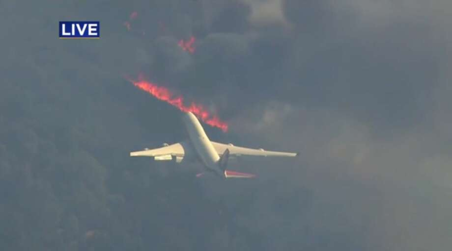 CalFire deployed its SuperTanker 747 to combat devastating fires burning in Wine Country Monday. Photo: KPIX-TV