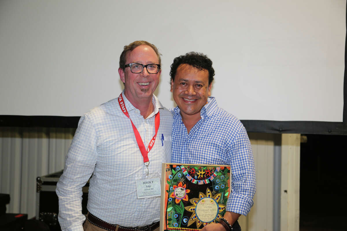 John T. Edge, director of the Southern Foodways Alliance, with Hugo Ortega, recipient of the 2017 Craig Claiborne Lifetime Achievement Award presented at the SFA's annual symposium in Oxford, Miss.