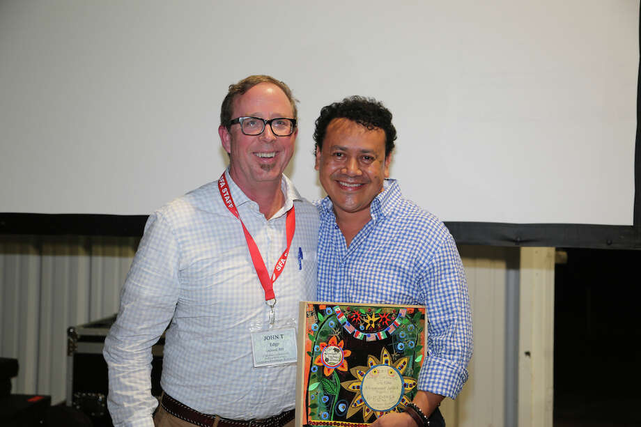 John T. Edge, director of the Southern Foodways Alliance, with Hugo Ortega, recipient of the 2017 Craig Claiborne Lifetime Achievement Award presented at the SFA's annual symposium in Oxford, Miss. Photo: Brandall Atkinson