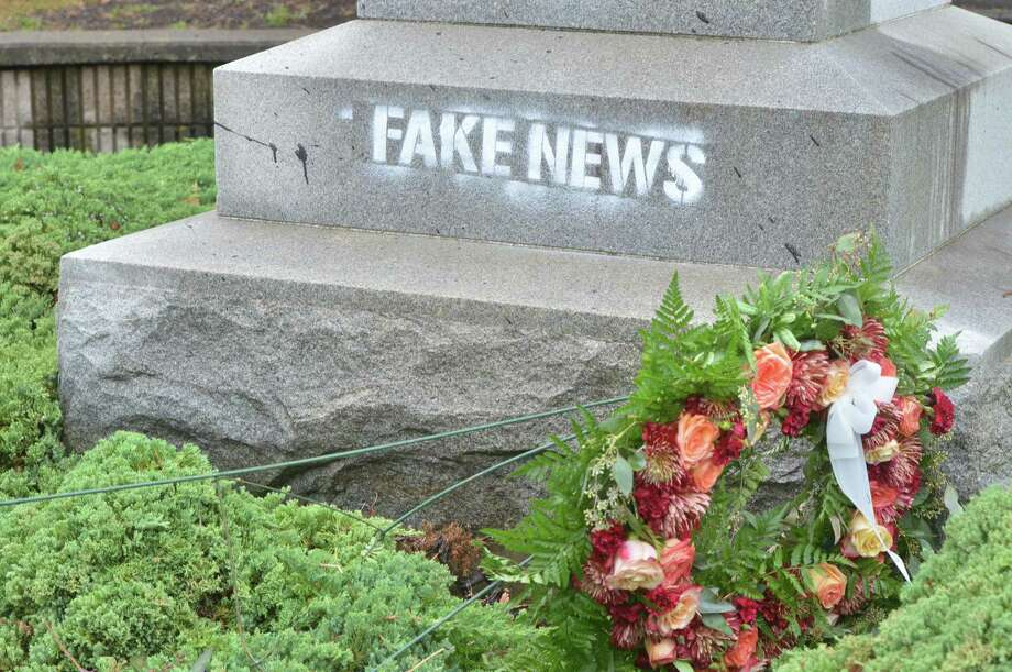 The statue of Christopher Columbus in Thomas C. O'Connor Park that includes The Heritage Wall on West Ave. was found to have the slogan Fake News stenciled on its base on Sunday October 8, 2017 in Norwalk Conn. Photo: Alex Von Kleydorff, Hearst Connecticut Media / Norwalk Hour