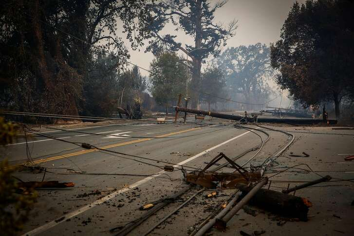 Power lines are seen on Old Redwood Highway after the Tubbs fire tore through the area in Santa Rosa, Calif., on Monday, Oct. 9, 2017.