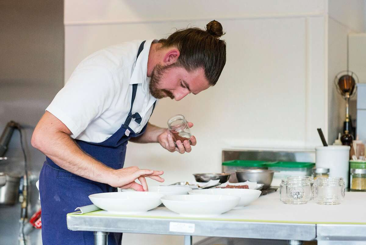 Michael Warring puts the finishing touches on a dish of ribeye with maiitake mushrooms, red verjus and sumac parsley, which was served as the fourth course at his restaurant Michael Warring in Vallejo, Calif., on Sunday, October 1, 2017. The restaurant offers a six course tasting menu with the option for wine or beer pairings.