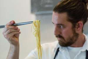 Michael Warring works on cooking a noodle dish with fairytale eggplant, guanciale, patron peppers and black truffle, which was served as the third course at his restaurant Michael Warring in Vallejo, Calif., on Sunday, October 1, 2017. The restaurant offers a six course tasting menu with the option for wine or beer pairings.