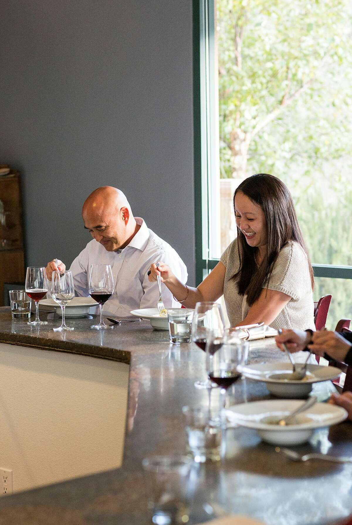 Stephen Partridge (left) dines with Mary Gee at the restaurant Michael Warring in Vallejo, Calif., on Sunday, October 1, 2017. The restaurant offers a six course tasting menu with the option for wine or beer pairings.