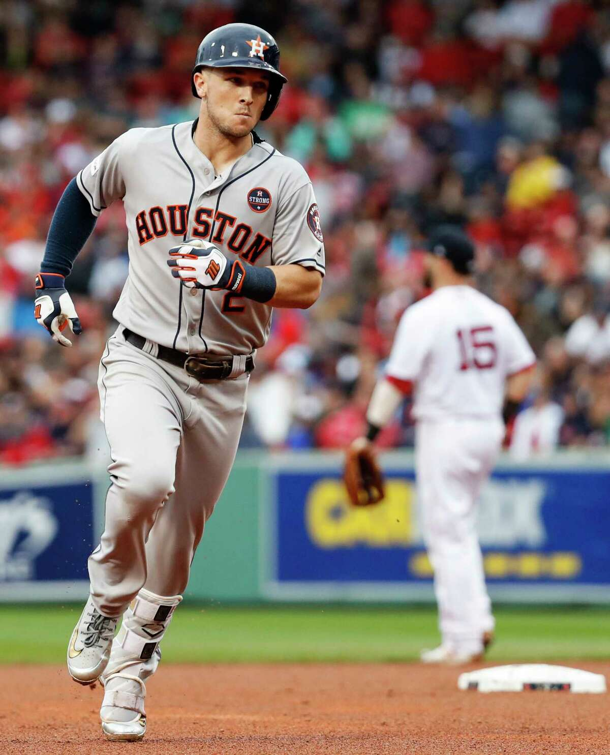 Houston Astros third baseman Alex Bregman (2) rounds the bases after hitting a solo home run off Boston Red Sox reliever Chris Sale to tie the game during the eighth inning of Game 4 of the ALDS at Fenway Park on Monday, Oct. 9, 2017, in Boston.