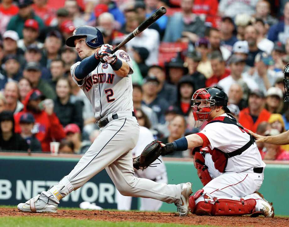 Houston Astros third baseman Alex Bregman (2) hits a solo home run off Boston Red Sox reliever Chris Sale to tie the game during the eighth inning of Game 4 of the ALDS at Fenway Park on Monday, Oct. 9, 2017, in Boston. Photo: Karen Warren, Houston Chronicle / © 2017 Houston Chronicle