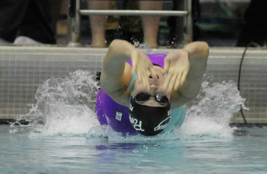 Pomperaug's Hallie Perrin took sixth in the 100-yard backstroke in Class L last year as a junior. Photo: Matthew Brown / Hearst Connecticut Media / Stamford Advocate