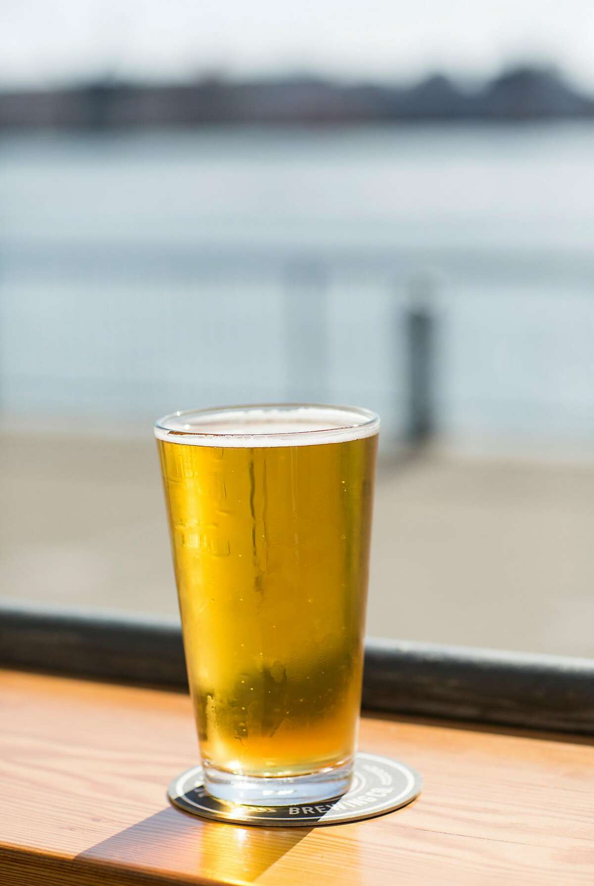A glass of Saginaw Golden Ale, the flagship ale of Mare Island Brewing Co., is seen at their taproom in the Vallejo Ferry Building in Vallejo, Calif., on Saturday, September 30, 2017. The brewery is in the final construction stages at the historic Coal Sheds on Mare Island where where they will be doing all their brewing.