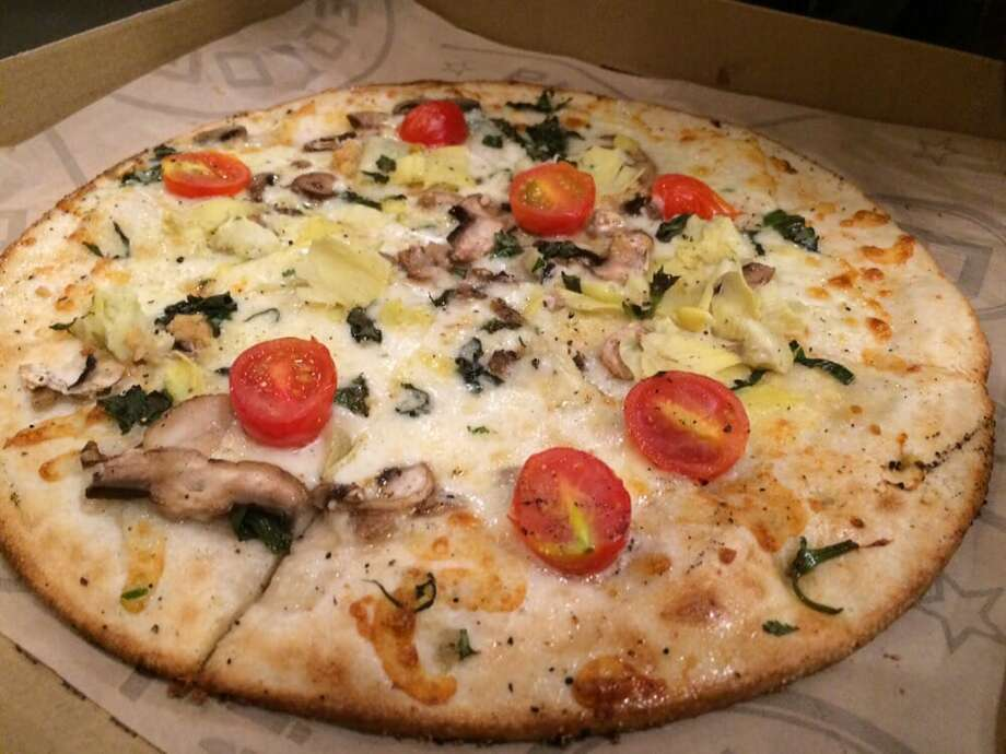 A fresh-baked pizza from Pieology. Photo: Geminyna J./Yelp