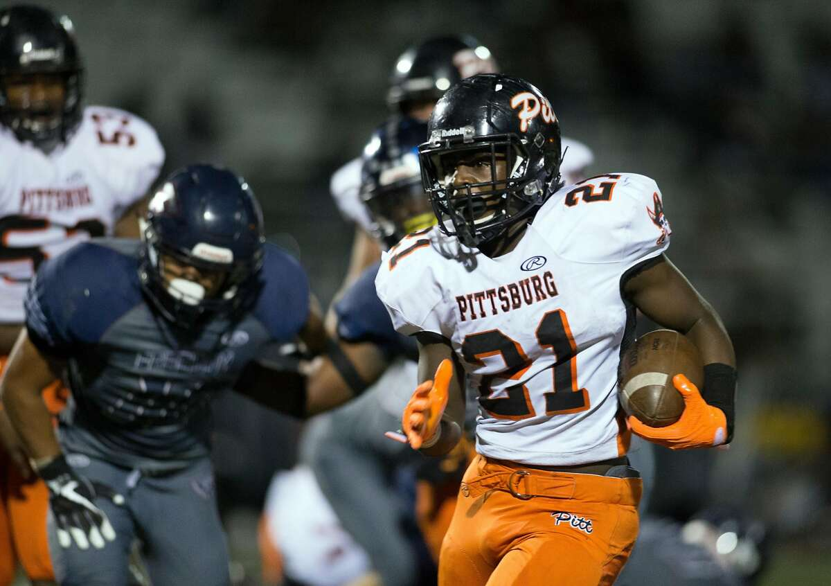 Pittsburg�s Darrion Bartley (21) runs for a big gain against Freedom during the fourth quarter of a high school football game, Friday, Oct. 6, 2017 in Oakley, Calif. Pittsburg won 47-33.