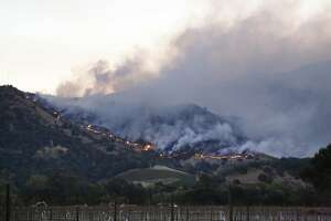 Fires burn jn the hills near the Silverado Trail  on Monday, October 9, 2017 in Yountville, Calif.
