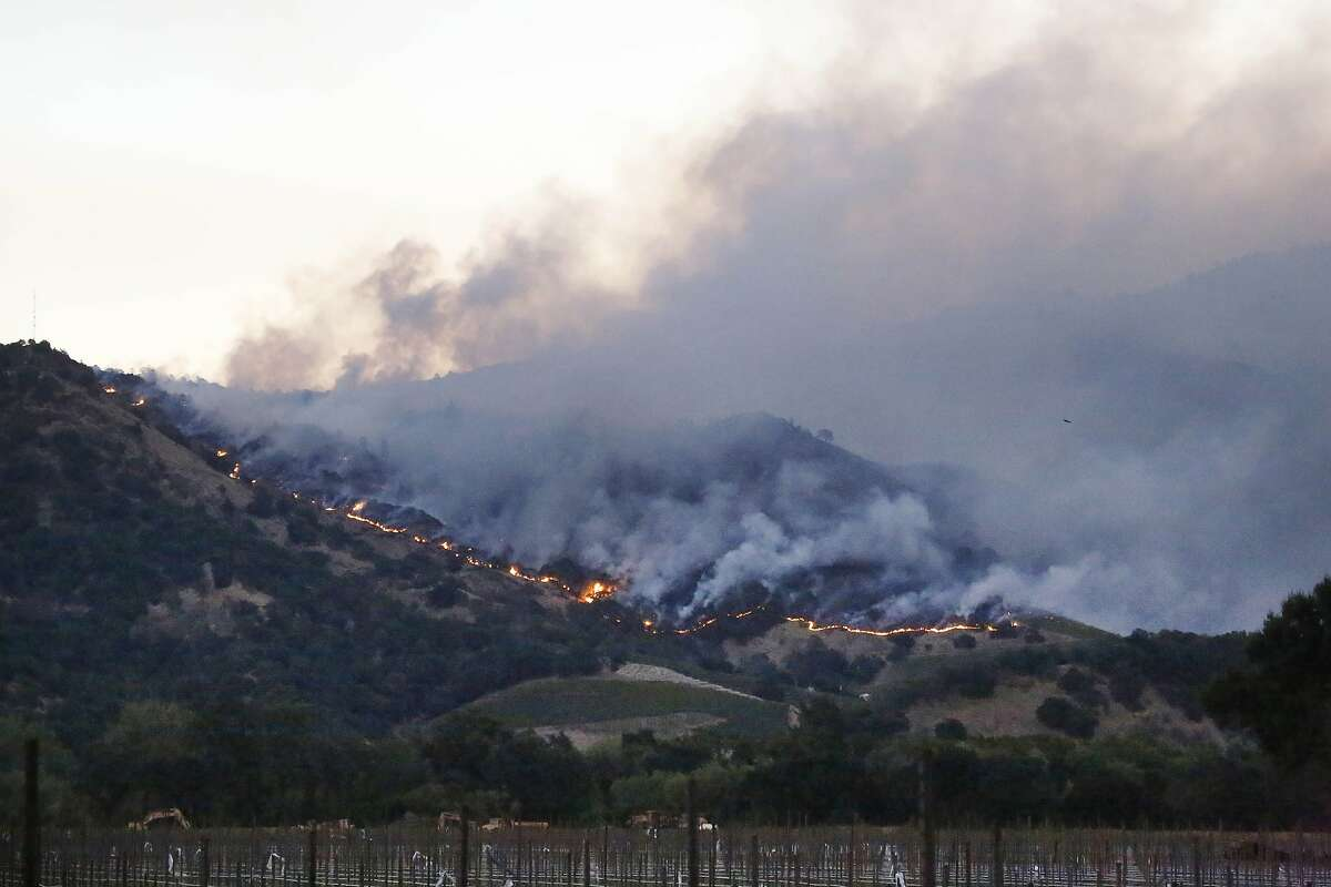 Fires burn in the hills near the Silverado Trail on Monday, October 9, 2017 in Yountville, Calif.