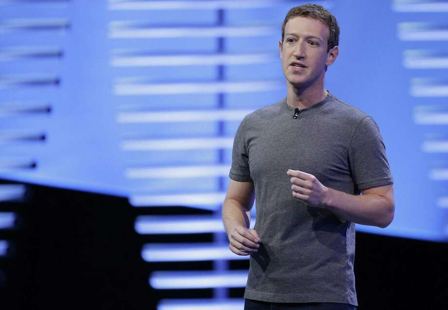 File photo of Facebook CEO Mark Zuckerberg speaks during the keynote address at the F8 Facebook Developer Conference in San Francisco. Facebook has unwittingly allowed groups backed by the Russian government to target users with ads. That's after it took months to acknowledge its outsized role in influencing the U.S. election by allowing for the spread of fake news. Now it is under siege, facing questions from lawmakers and others seeking to rein in its enormous power and demand more transparency. Photo: Eric Risberg /Associated Press / Copyright 2016 The Associated Press. All rights reserved. This material may not be published, broadcast, rewritten or redistribu
