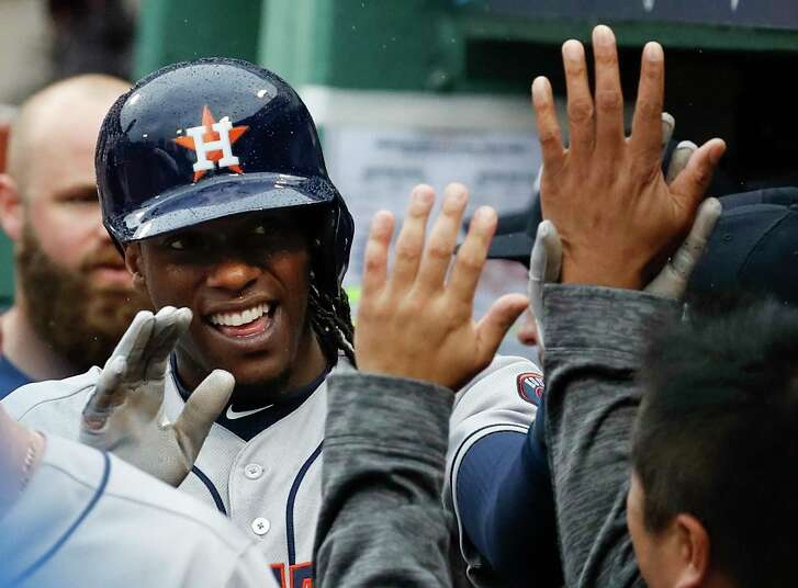 Houston Astros pinch runner Cameron Maybin (3) high fives his teammates in the dugout after scoring on a single, off of Boston Red Sox reliever Craig Kimbrel, by Josh Reddick during the eighth inning of Game 4 of the ALDS at Fenway Park on Monday, Oct. 9, 2017, in Boston. Maybin was running for Evan Gattis, who singled.