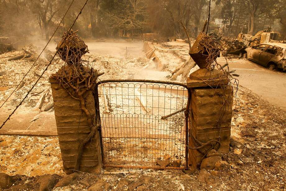 Front gate to a property in Glen Ellen on Oct. 9, the day after fires erupted across the North Bay. A consumer group wants California regulators to suspend deposits for new utility accounts in places hit by the fires. Photo: Peter DaSilva, Special To The Chronicle