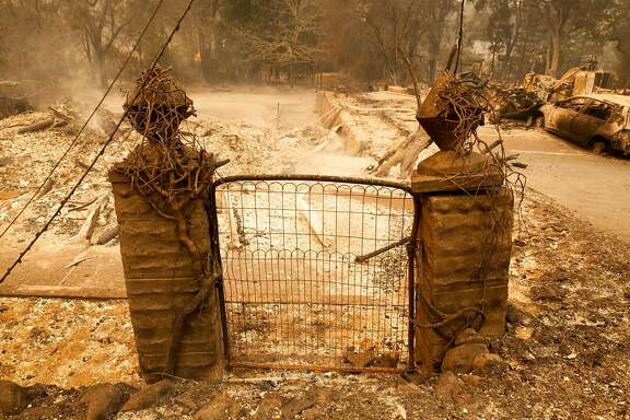 Front gate to a property along WarnSprings Rd. in Glen Ellen, CALIFORNIA, USA 9 Oct 2017. Multiple fires that erupted in Napa, Sonoma, Calistoga and the Santa Rosa area have burned homes and wineries. Mandatory evacuations have be displaced hundreds of residents through out the area.