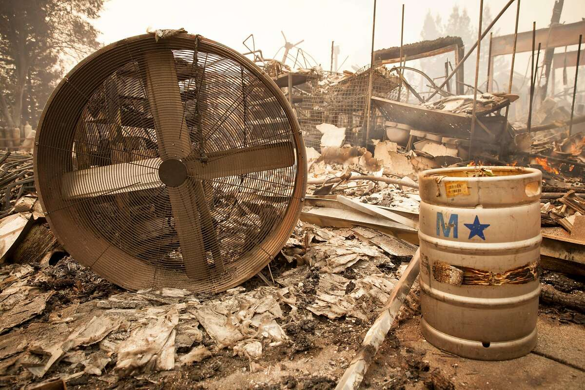 A fan and a keg were only a few items that were still recognizable after the a fast moving wind whipped wild fire roared through the Hilton Hotel burning it to the ground, Santa Rosa CALIFORNIA, USA 9 Oct 2017. Multiple fires that erupted in Napa, Sonoma, Calistoga and the Santa Rosa area have burned homes and wineries. Mandatory evacuations have be displaced hundreds of residents through out the area.