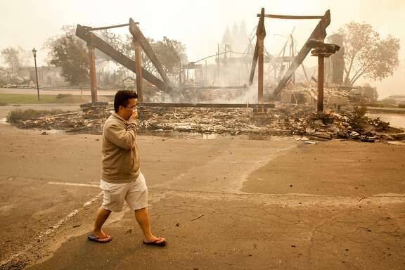 A visiting tech worker from Malaysia who was staying at the Hilton Hotel and lost everything he had, walks past the main portico to the hotel after a fast moving wind whipped wild fire roared through the hotel, burning it to the ground, Santa Rosa CALIFORNIA, USA 9 Oct 2017. Multiple fires that erupted in Napa, Sonoma, Calistoga and the Santa Rosa area have burned homes and wineries. Mandatory evacuations have be displaced hundreds of residents through out the area.