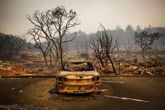 A car is seen burnt and charred after the Tubbs fire tore through dozens of homes off of Bicentennial Way in Santa Rosa, Calif., on Monday, Oct. 9, 2017.