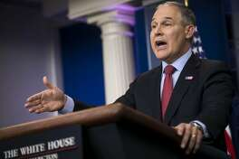 FILE -- Scott Pruitt, administrator of the Environmental Protection Agency,  speaks to reporters at the White House on June 2, 2017.   The Trump administration announced Oct. 9, 2017,  that it would take formal steps to repeal President Barack Obama's signature policy to curb greenhouse gas emissions from power plants, setting up a bitter fight over the future of America's efforts to tackle global warming.  (Al Drago/The New York Times)